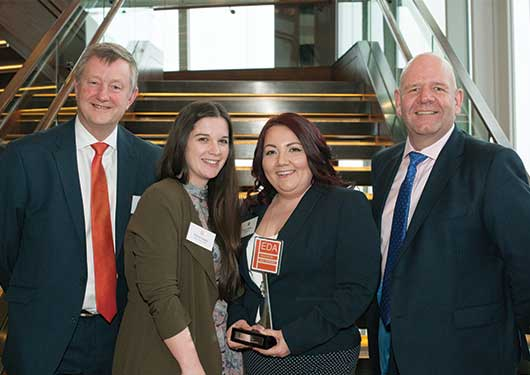 Winner Kerry Simm with her colleagues from Meggaman