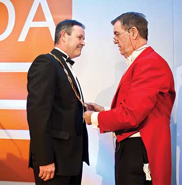 Tom Jones receiving EDA Presidential Chain of Office