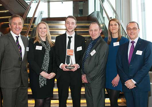 Winner Tom Simmons with colleagues from KEW Electrical and Fegime UK