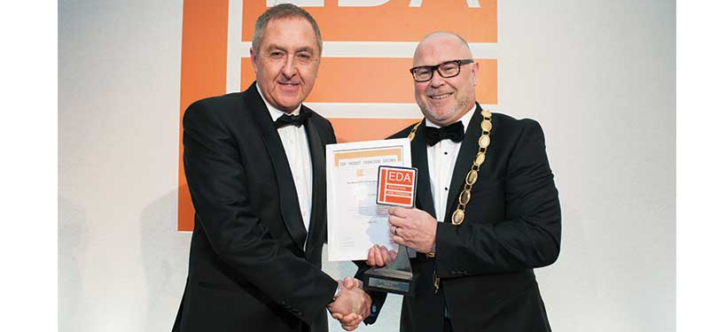 Fegime's Alan Reynolds receives his EDA Investor in Training Award from President Chris Gibson