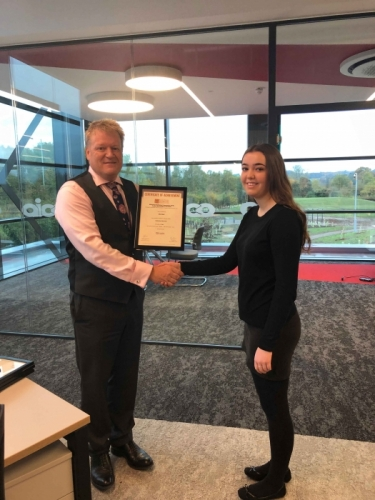 AICO Apprentice, Ella Shail, receiving his certificate from Managing Director, Neal Hooper