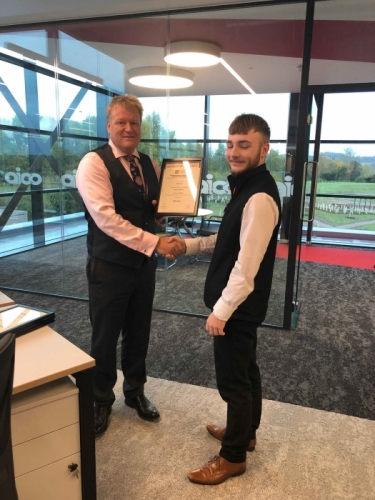 AICO Apprentice, Owen Terry, receiving his certificate from Managing Director, Neal Hooper