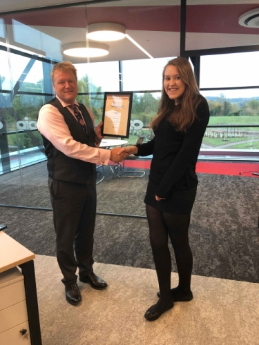 AICO Apprentice, Steph Wale-Walton, receiving his certificate from Managing Director, Neal Hooper