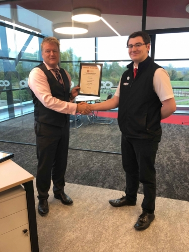 AICO Apprentice, Samuel Marston, receiving his certificate from Managing Director, Neal Hooper