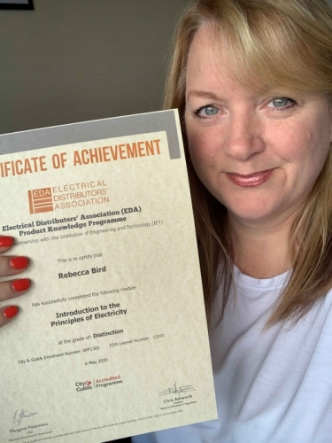 National Account Manager at Electrium Sales, Becky Bird, with her Distinction certificate for Introduction to the Principles of Electricity