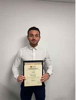 Ben Jones with his certificate of achievement for Heating and Ventilation
