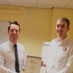 Ben Skidmore (r) of UK Spares, receiving his certificate from Manager Ross Graham (l)