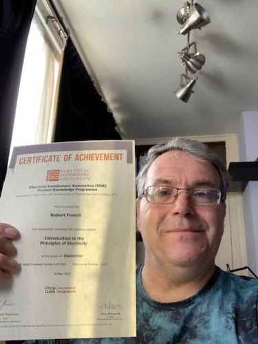 Bob French, Regional Sales Manager from Electrium Sales and his Distinction Certificate for completing Introduction to the Principles of Electricity