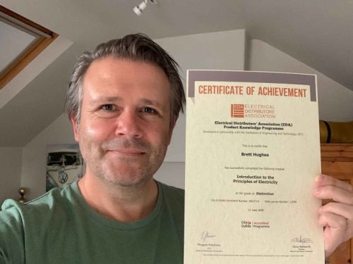 Specification Manager at Electrium Sales, Brett Hughes, recently completed his Introduction to the Principles of Electricity. Here he is at home with his well earned Distinction certificate