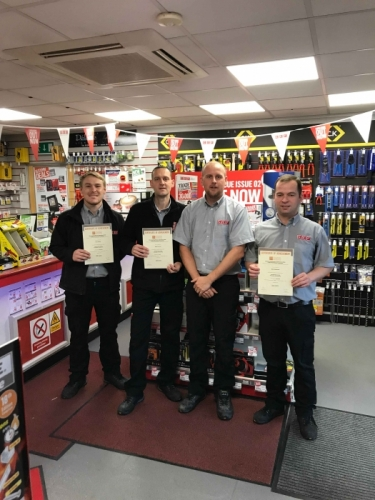 Congratulations on successfully completing the following module ; Introduction To the Principles of Electricity. Assistant Manager Kevin Keith presented their Certificate Of Achievement`s.  From left to right Kurt Harvey van driver (Distinction ), Jason Farman stores assistant (Credit), Kevin Keith Assistant manager , Ben Braidwood stores assistant (Distinction) .