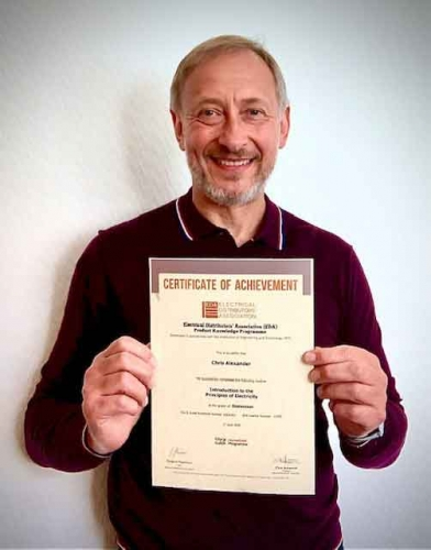 Chris Alexander, Area Sales Manager at Electrium Sales, proudly holding up his Distinction certificate for his first EDA Product Knowledge Module