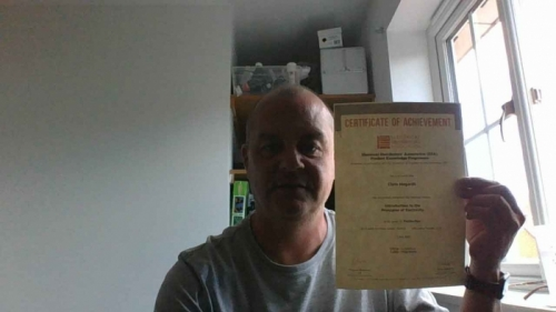 National Sales Manager, Chris Hogarth from Electrium Sales at home with his Distinction certificate for Introduction to the Principles of Electrcity
