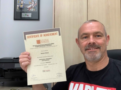 Darren Clancy, Area Sales Manager at Electrium Sales, proudly showing off his Distinction certificate for Distribution, Switchgear and Protection