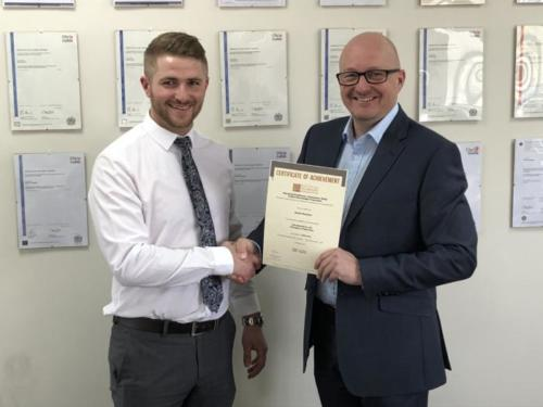 Daniel Bennion of Deta Electrical Company (l) receiving his Distinction certificate for his first EDA module Intro to the Principles of Electricity from manager Don Simler (r)