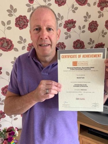 David Turk, Area Sales Manager from Electrium Sales, with his first Distinction certificate for completing Introduction to Principles of Electricity