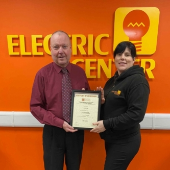 Donna Lake of Electric Center, Paignton, with her Branch Manager Stephen Geare, presenting her with her certificate of achievement