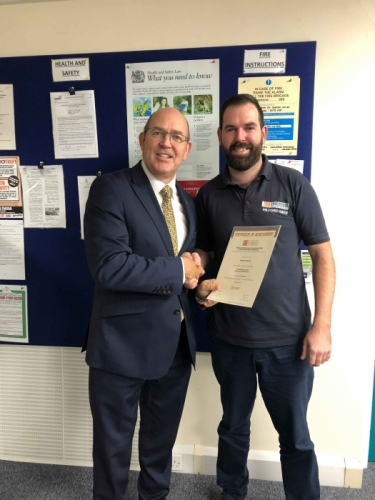 Peter Brittain, Edmundson Electrical Ltd, Wales & West Regional director presenting Aaron Clayton with his certificate