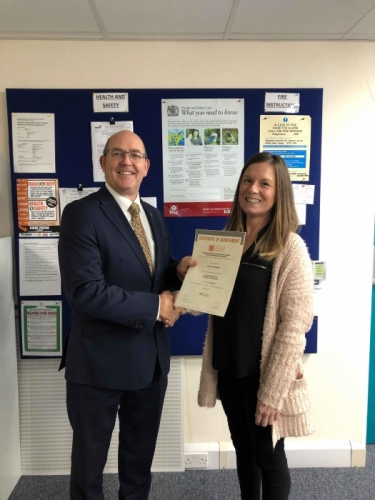 Peter Brittain, Edmundson Electrical Ltd, Wales & West Regional director presenting Cheryl Thornbery with her certificate
