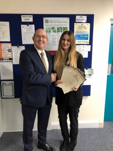Peter Brittain, Edmundson Electrical Ltd, Wales & West Regional director presenting Tamara Morris with her certificate