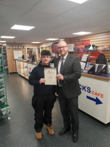Harry Smith (l) of GA Nicholas, Walsall, receiving his Distinction certificate from manager Joe Roberts (r)