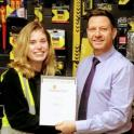 Harriet Eagle (l) Edmundson Electrical, King's Lynn, receiving her Distinction certificate from manager David Grimes (l)