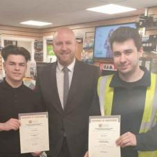 Harry Smith (l) and Rhys Turner (r), GA Nicholas, Walsall, receiving their certificates from Manager Joe Roberts (m)