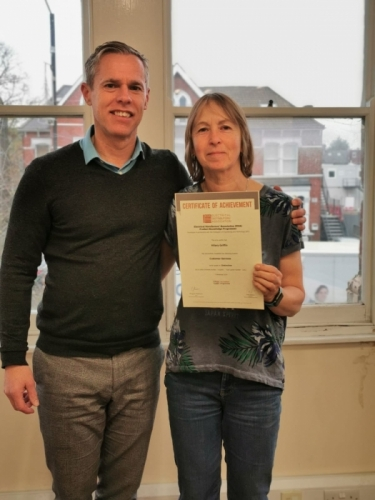 Medlocks Hilary Griffin receiving her certificate for a Distinction from her Manager, Stewart Jones.