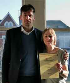Medlocks Hillary Griffin, receiving her certificate for Introduction to the Principles of Electricity from Director, Peter Moore