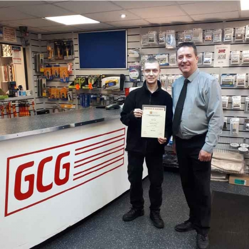 GCG Electrical Wholesaler, Jamie Cooper receiving his EDA Certificate from Manager, Tim Follows