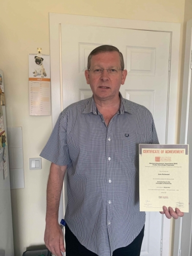 Electrium's Regional Sales Manager for Scotland, John Richmond, with his Distinction certificate for his first module Introduction to the Principles of Electricity.