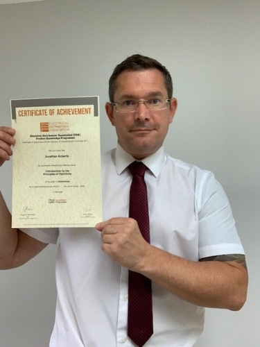John Roberts, Area Sales Manager from Electrium Sales, with his first Distinction certificate for completing Introduction to Principles of Electricity