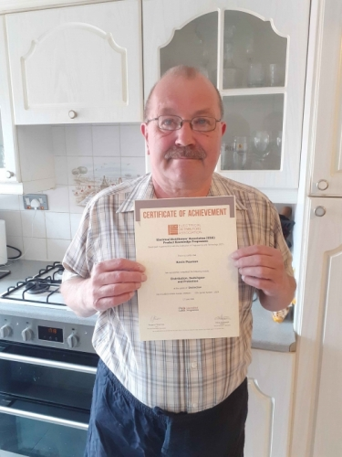 Electrium's Estimating Engineer, Kevin Pearson, with his Distinction certificate for his first module