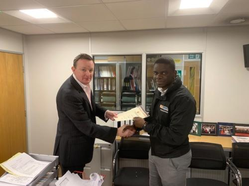 Louis Narebor-Tueje (r) of Edmundson Electrical, Blackfriars, receiving his Distinction certificate for his first module, Introduction to the Principles of Electricty, from manager Paul Conneely (l)