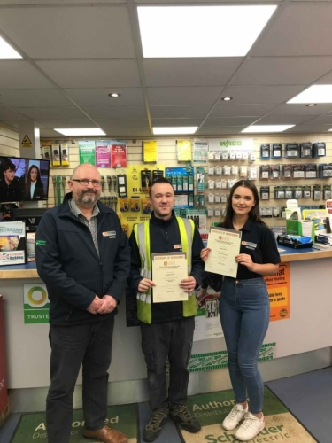 Megan Wilkes and Bradley Quirke receiving their certificates from Branch Manager Nigel Whitehouse
