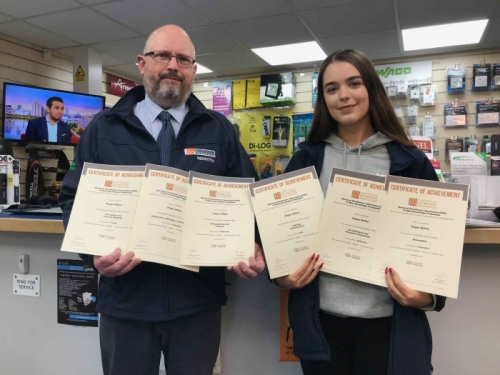 Edmundsons Megan Wilkes and her Manager, Nigel Whitehouse, holding her six certificates of achievement