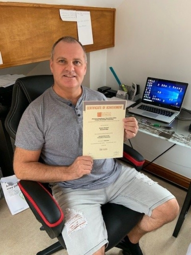 Regional Sales Manager, Rob Stewart-Brackenridge from Electrium Sales, showing that learning doesn't stop at home. Here he is with his Distinction Certificate for his first module Intro to Principles of Electricity