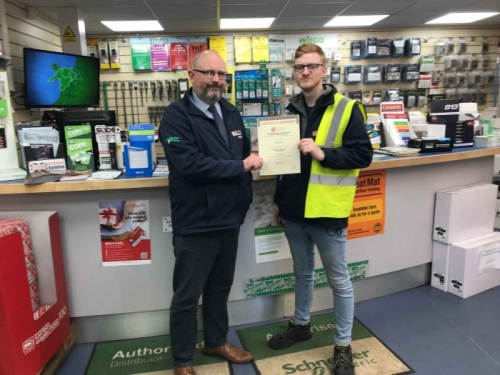 Rory Harrison of Edmundson Redditch, receiving his certificate from Branch Manager Nigel Whitehouse