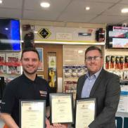 "Ryan Potts (l) of Edmundson Electrical, Sunderland, receiving certificate from his manager Andy O'Hair (r). Ryan says ""The Modules have helped me gain confidence when discussing products with customers, and understanding what they require when serving on the trade counter."""