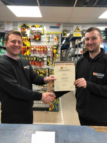 Matt Cox(r), of Edmundson Electrical Torquay, receiving his Certificate of Achievement from Branch Manager, David Martini