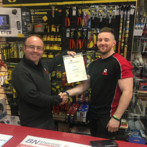 Ed Trenholme of Upex Electrical Distributors in Yorkshire, secures a Distinction in his first module - Principles of Electricity. Pictured here with manager, Dan Mooney.