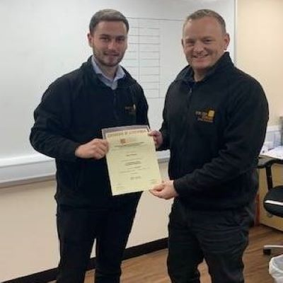 Oli Barnes (left) from Electric Center, Cheltenham receiving his product knowledge certificate from Manager, Steve Rogers