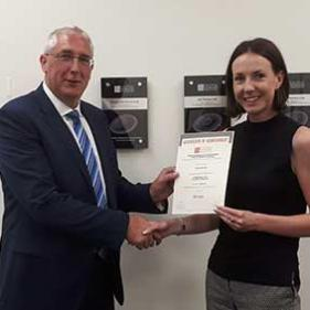 Stearn's Mary Burrows receiving her Distinction certificate from Commercial Director, Fraser Ballantyne