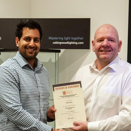 Mikesh Mistry, Internal Project Manager at Collingwood Lighting gets his Distinction certificate for Lighting Systems and Controls from Gareth Petley, Projects Sales Director.
